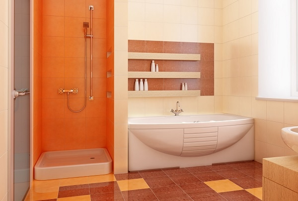 orange bathroom shower tiles with white bath