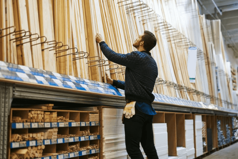 man choosing wood in warehouse